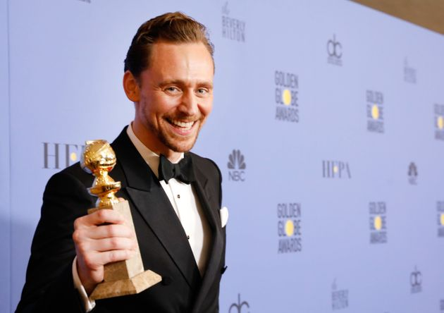 Tom Hiddleston with his gong for 'The Night