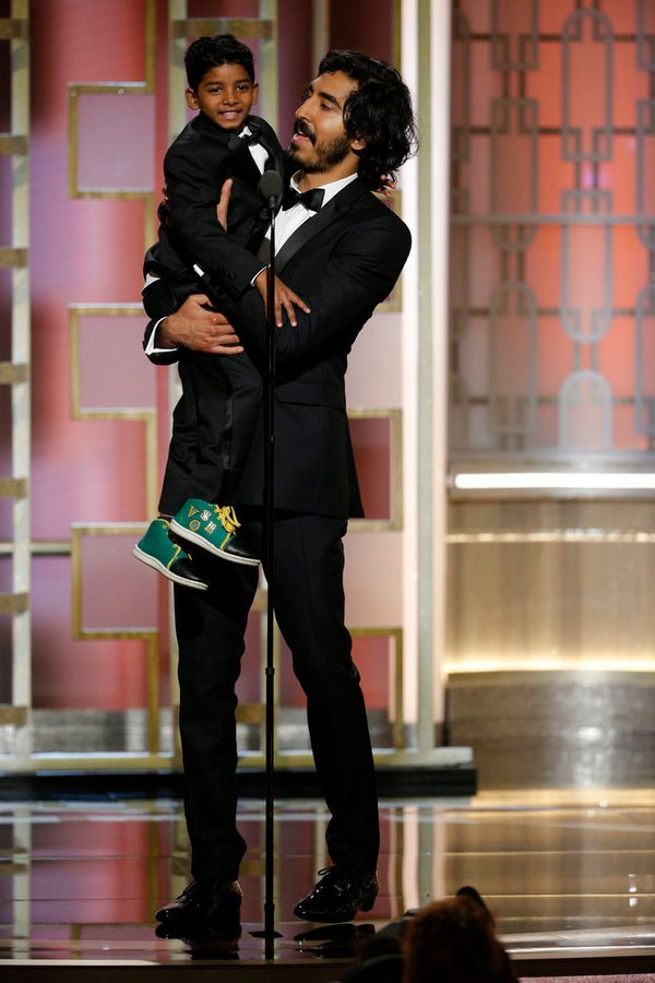 Dev Patel brings Sunny Pawar onstage for the cutest moment of the night.