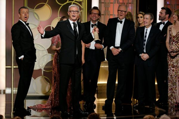 """Stephen Daldry and the cast of """" The Crown"""" accept the award for Best Television Series, Drama."""