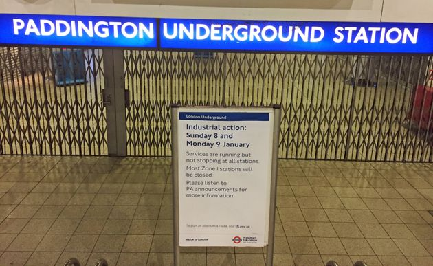 A sign warns commuters of the strike outside Paddington Underground