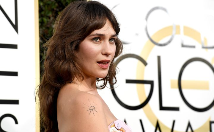 Lola Kirke rocked a pink Andrew Gn dress...and matching pink pin.