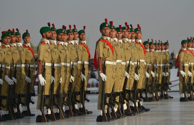 Pakistani military cadets march on the birth anniversary of the country's founder Mohammad Ali Jinnah...