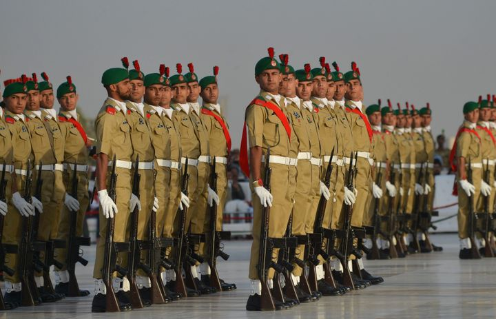 Pakistani military cadets march on the birth anniversary of the country's founder Mohammad Ali Jinnah at his mausoleum in Kar