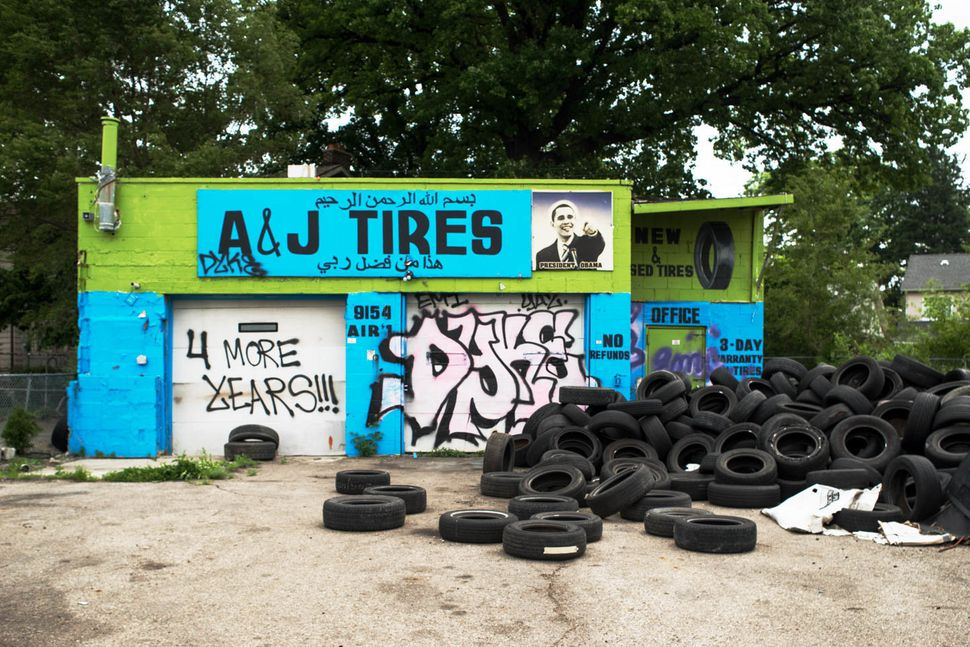 Abandoned A and J Tires store, 9154 Livernois Ave., Detroit, 2014.
