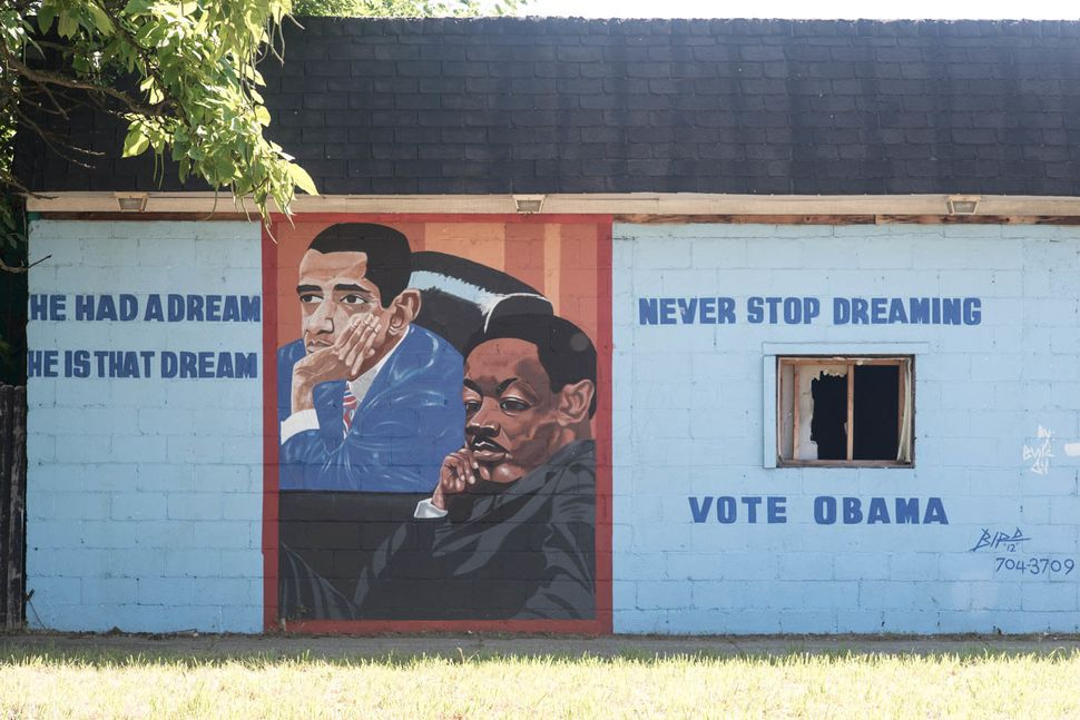 "Mural depicting Obama and Martin Luther King Jr. by Lee ""Bird"" Walker, East 7 Mile Road at Hamburg Avenue, Detroit, 2015.<a h"