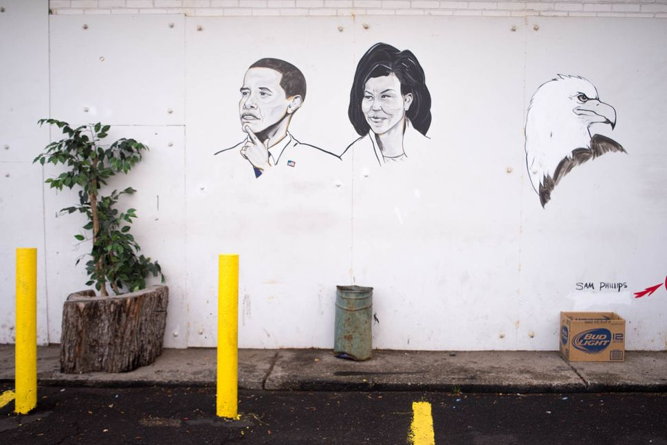 Mural depicting Barack and Michelle Obama witheagle by Sam Phillips, Fair Party Store, 6541 Gratiot Ave., Detroit, 2013