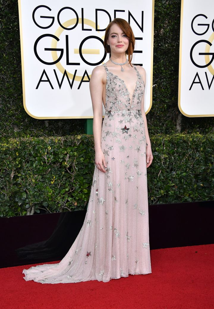 Emma Stone attends the 74th Annual Golden Globe Awards in a pink dress.