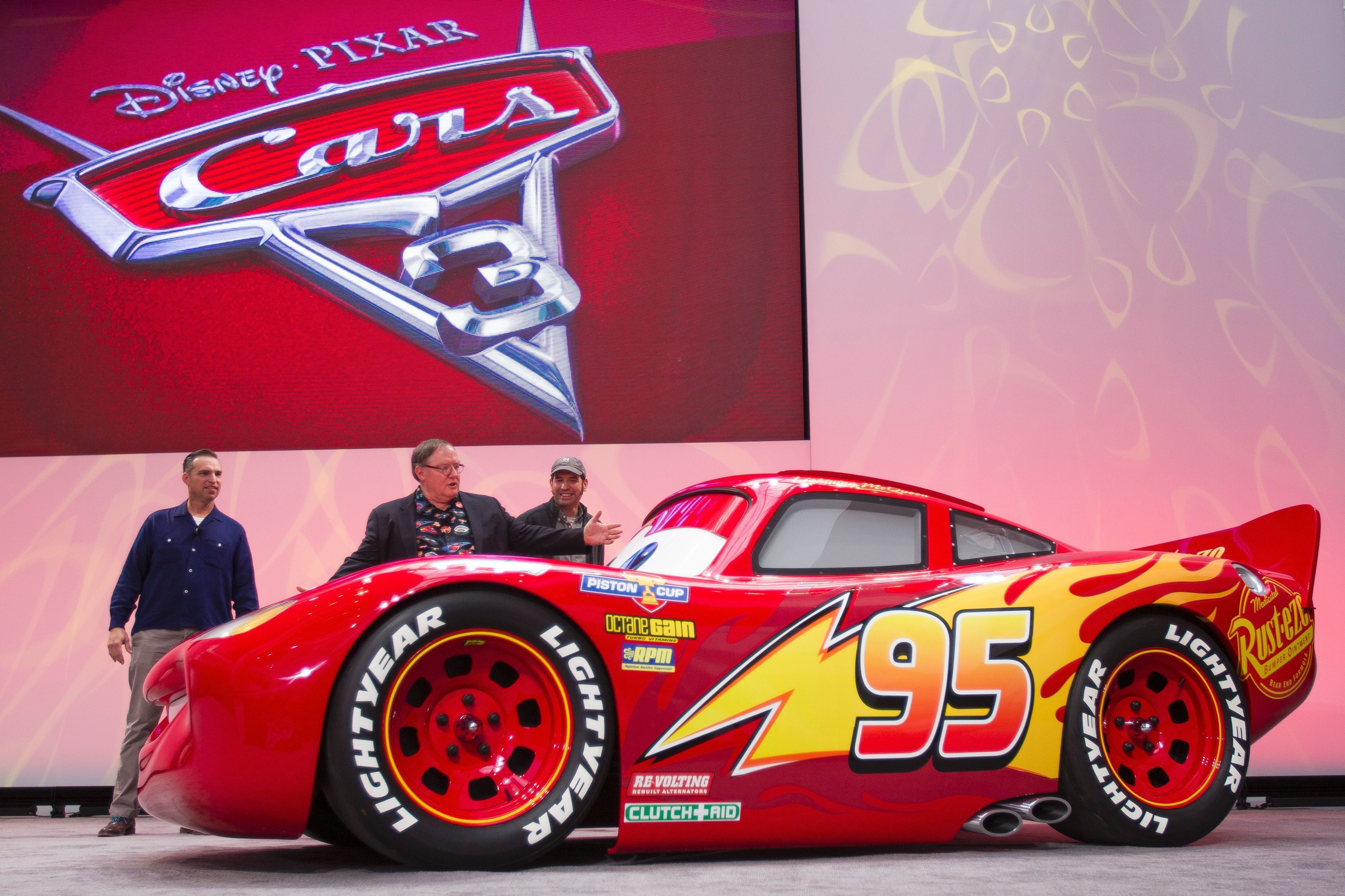 A Life Size Version Of Lightning Mcqueen Drives Onstage To Unveil His New Paint Job