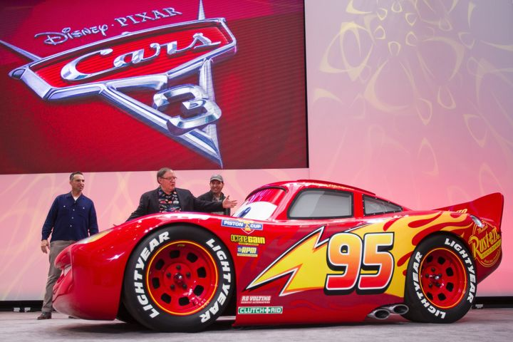 A life-size version of Lightning McQueen drives onstage to unveil his new paint job for the upcoming movie 'Cars 3'.