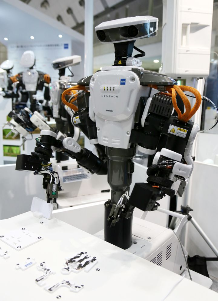 Kawada Industry's Nextage, a humanoid robot, at the International Robot Exhibition started in Tokyo on Dec. 2, 2015.