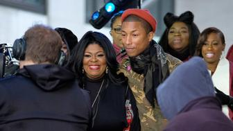 NEW YORK, NY - DECEMBER 09:  Pharrell Williams (R) and Kim Burrell pose onstage during the Citi Concert Series on TODAY at Rockefeller Center on December 9, 2016 in New York City.  (Photo by D Dipasupil/Getty Images for CITI)