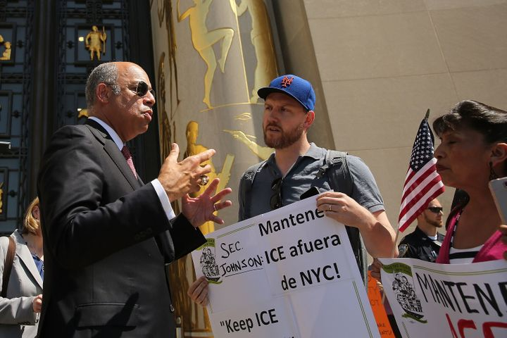 Pro-immigration protesters confront Secretary of Homeland Security Jeh Johnson on May 7, 2015 in New York City.Programs