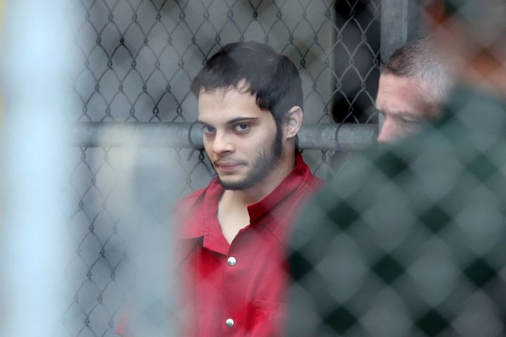 Esteban Santiago is taken from the Broward County main jail as he is transported to the federal courthouse Monday, Jan. 9, 20