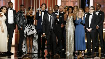 BEVERLY HILLS, CA - JANUARY 08: In this handout photo provided by NBCUniversal, director Barry Jenkins and the cast and crew of 'Moonlight' accept the award for Best Motion Picture - Drama for 'Moonlight' onstage during the 74th Annual Golden Globe Awards at The Beverly Hilton Hotel on January 8, 2017 in Beverly Hills, California. (Photo by Paul Drinkwater/NBCUniversal via Getty Images)
