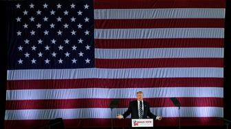 "U.S. President-elect Donald Trump speaks beneath a giant American Flag during a ""Thank You USA"" tour rally in Baton Rouge, Louisiana, U.S., December 9, 2016.  REUTERS/Mike Segar"