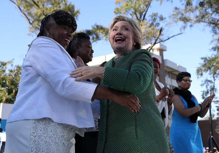 Democratic presidential nominee Hillary Clinton, right, hugs Gwen Carr the mother of Eric Garner, during a campaign rall