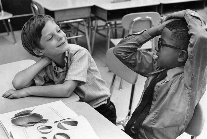 A black and white student get acquainted on their first day together at a desegregated school in 1969. Hide your white daught