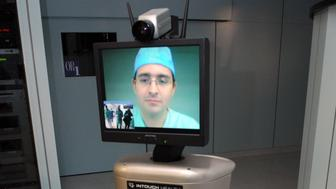 FRANCE - JANUARY 12:  IRCAD- Institute of Research against the Cancer of the Digestive system- EITS- European Institute off TeleSurgery in Strasbourg, France on January 12th, 2009- The robot IN TOUCH.  (Photo by Pool DEMANGE/MARCHI/Gamma-Rapho via Getty Images)