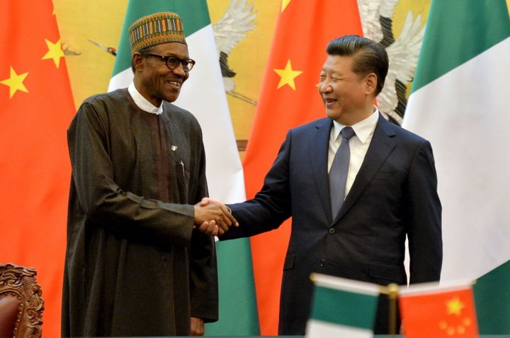 Nigerian President Muhammadu Buhari and Chinese President Xi Jinping shake hands during a signing ceremony at the Great Hall