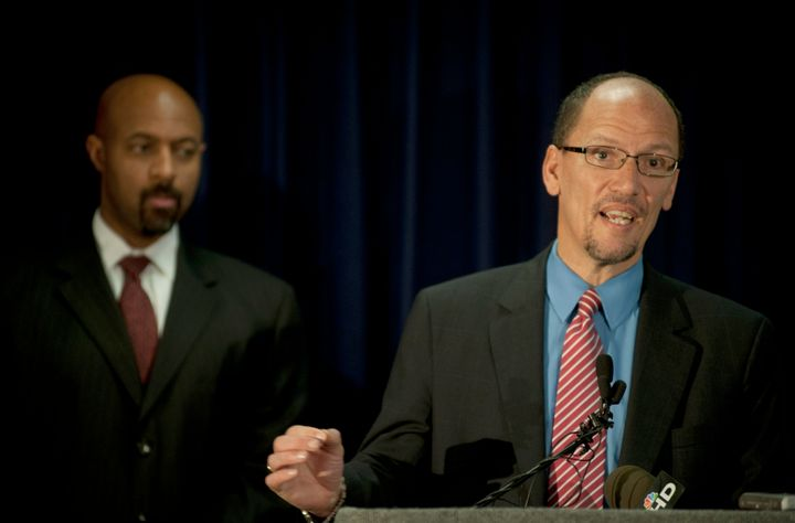 Tom Perez, right, then chief of the Department of Justice's Civil Rights Division, outlines racial profiling findings on the