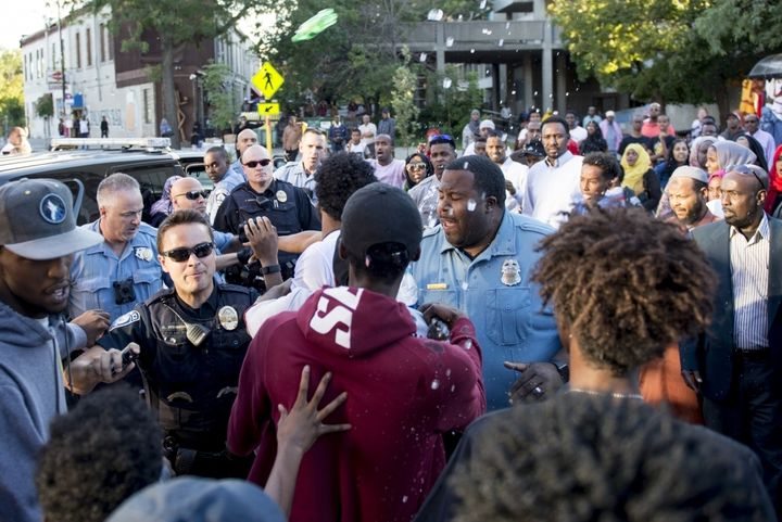Minneapolis police escalate a peaceful protest at K'Naan's cedar block party.