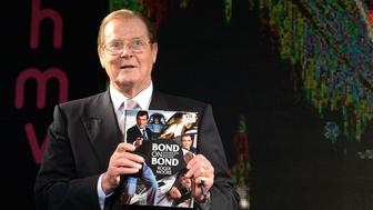 LONDON, ENGLAND - OCTOBER 22:  Sir Roger Moore signs copies of his book 'Bond on Bond' at HMV, Oxford Street on October 22, 2012 in London, England.  (Photo by Ben Pruchnie/WireImage)
