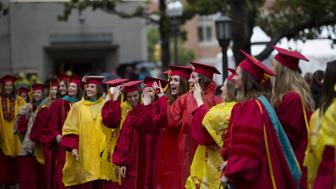 Graduating students walk to their seats during USC's Commencement Ceremony at the University of Southern California in Los Angeles, California, U.S. May 15, 2015. To match Special Report COLLEGE-CHARITY/ REUTERS/Mario Anzuoni/File Photo