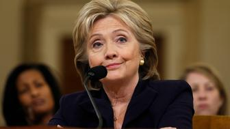 Democratic presidential candidate Hillary Clinton listens to a question as she testifies before the House Select Committee on Benghazi, on Capitol Hill in Washington October 22, 2015. The congressional committee is investigating the deadly 2012 attack on the U.S. diplomatic mission in Benghazi, Libya, when Clinton was the secretary of state.         REUTERS/Jonathan Ernst