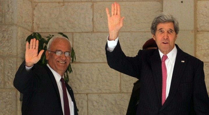 <p>U.S. Secretary of State John Kerry (R) and Palestinian chief negotiator Saeb Erekat (L) wave before a meeting with Palestinian Authority President Mahmoud Abbas at the presidential compound in Ramallah January 4, 2014.</p>