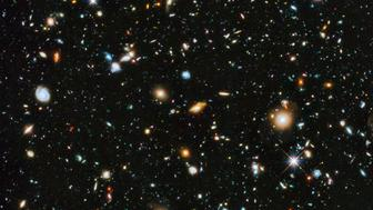 A composite of separate exposures taken in 2003 to 2012 with Hubble's Advanced Camera for Surveys and Wide Field Camera 3 of the evolving universe is shown in this handout photo provided by NASA, June 3, 2014.  Researchers say the image, from a new study called the Ultraviolet Coverage of the Hubble Ultra Deep Field, provides the missing link in star formation. Made from 841 orbits of telescope viewing time, it contains approximately 10, 000 galaxies, extending back in time to within a few hundred million years of the big bang, according to NASA.  REUTERS/HUDF/NASA/Handout via Reuters   (OUTERSPACE - Tags: SCIENCE TECHNOLOGY) ATTENTION EDITORS - FOR EDITORIAL USE ONLY. NOT FOR SALE FOR MARKETING OR ADVERTISING CAMPAIGNS. THIS IMAGE HAS BEEN SUPPLIED BY A THIRD PARTY. IT IS DISTRIBUTED, EXACTLY AS RECEIVED BY REUTERS, AS A SERVICE TO CLIENTS