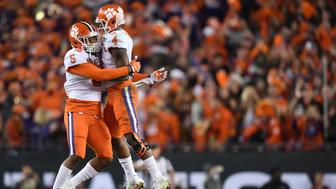 Jan 9, 2017; Tampa, FL, USA; Clemson Tigers quarterback Deshaun Watson (4) celebrates with linebacker Shaq Smith (5) during the fourth quarter against the Alabama Crimson Tide in the 2017 College Football Playoff National Championship Game at Raymond James Stadium. Mandatory Credit: John David Mercer-USA TODAY Sports