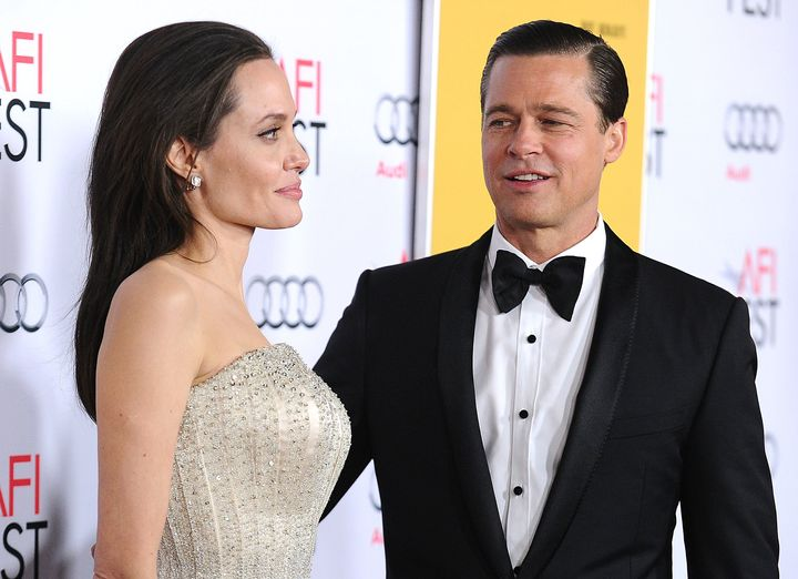 "Angelina Jolie and Brad Pitt attend the ""By the Sea"" premiere."