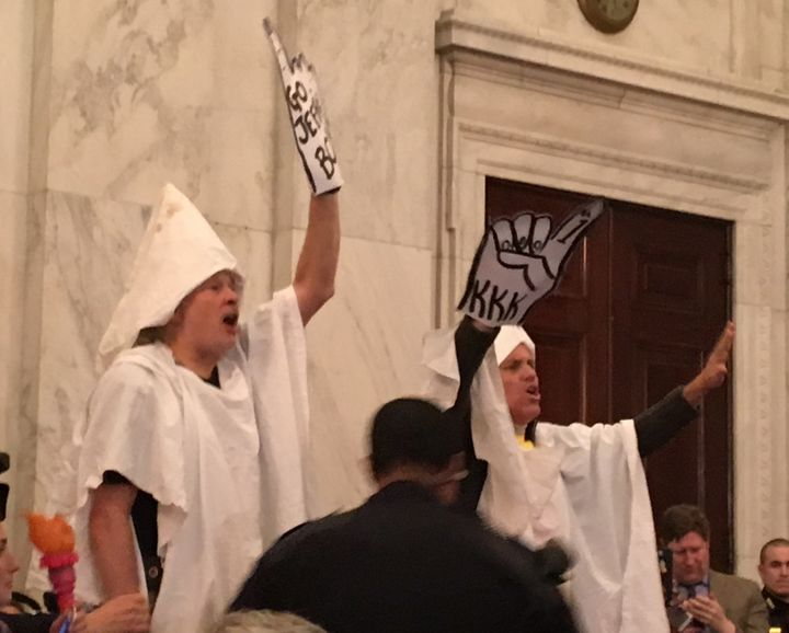 Protesters dressed as members of the Ku Klux Klan greet Sen. Jeff Sessions at his attorney general confirmation hearing Tuesd