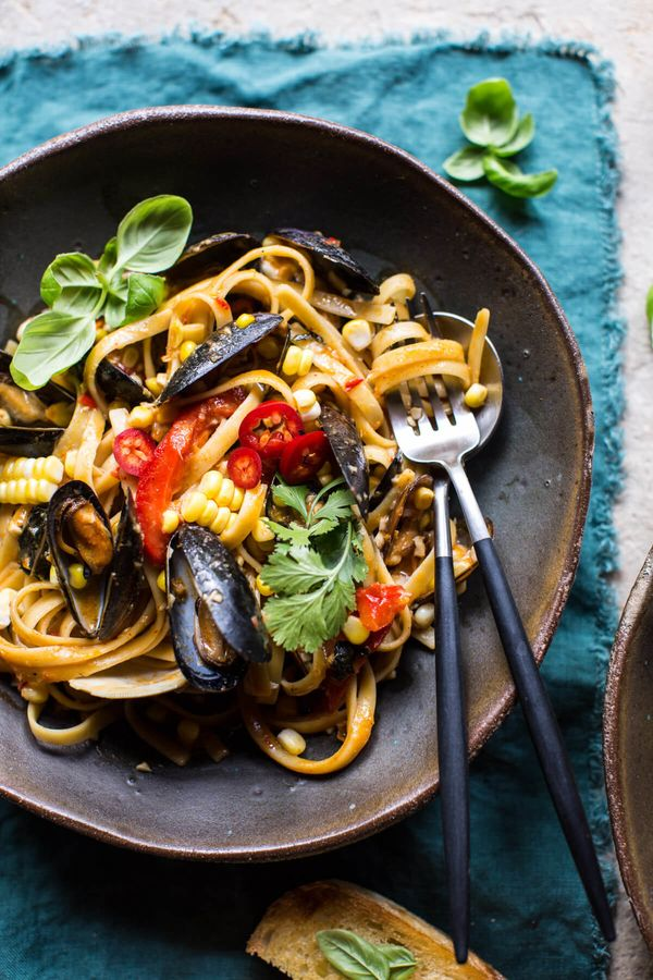 """<strong>Get the <a href=""""http://www.halfbakedharvest.com/basil-coconut-curry-pasta-clams-mussels-corn/"""" target=""""_blank"""">Basil"""
