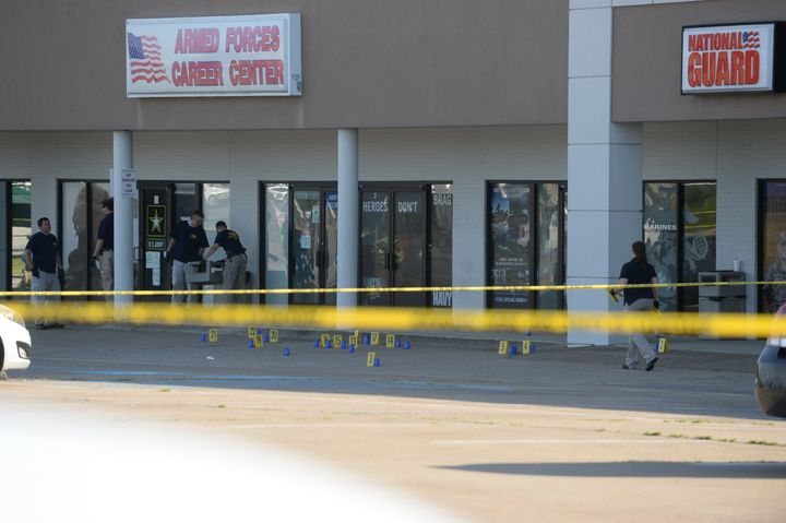 Members of the FBI Evidence Response Team work the scene of a shooting at a Armed Forces Career Center/National Guard recruit