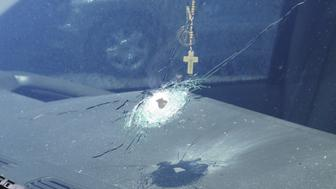 A bullet hole is shown in a windshield of a car that was traveling on Interstate 10 in Phoenix, Arizona in the handout photo released to Reuters, September 1, 2015. Arizona state troopers sought the public's help on Monday as they investigated a rash of shootings along an interstate highway in Phoenix that police said left four vehicles pocked with bullet holes during the past three days. REUTERS/Arizona Department of Public Safety/Handout  ATTENTION EDITORS -THIS IMAGE HAS BEEN SUPPLIED BY A THIRD PARTY. IT IS DISTRIBUTED, EXACTLY AS RECEIVED BY REUTERS, AS A SERVICE TO CLIENTS. FOR EDITORIAL USE ONLY. NOT FOR SALE FOR MARKETING OR ADVERTISING CAMPAIGNS.