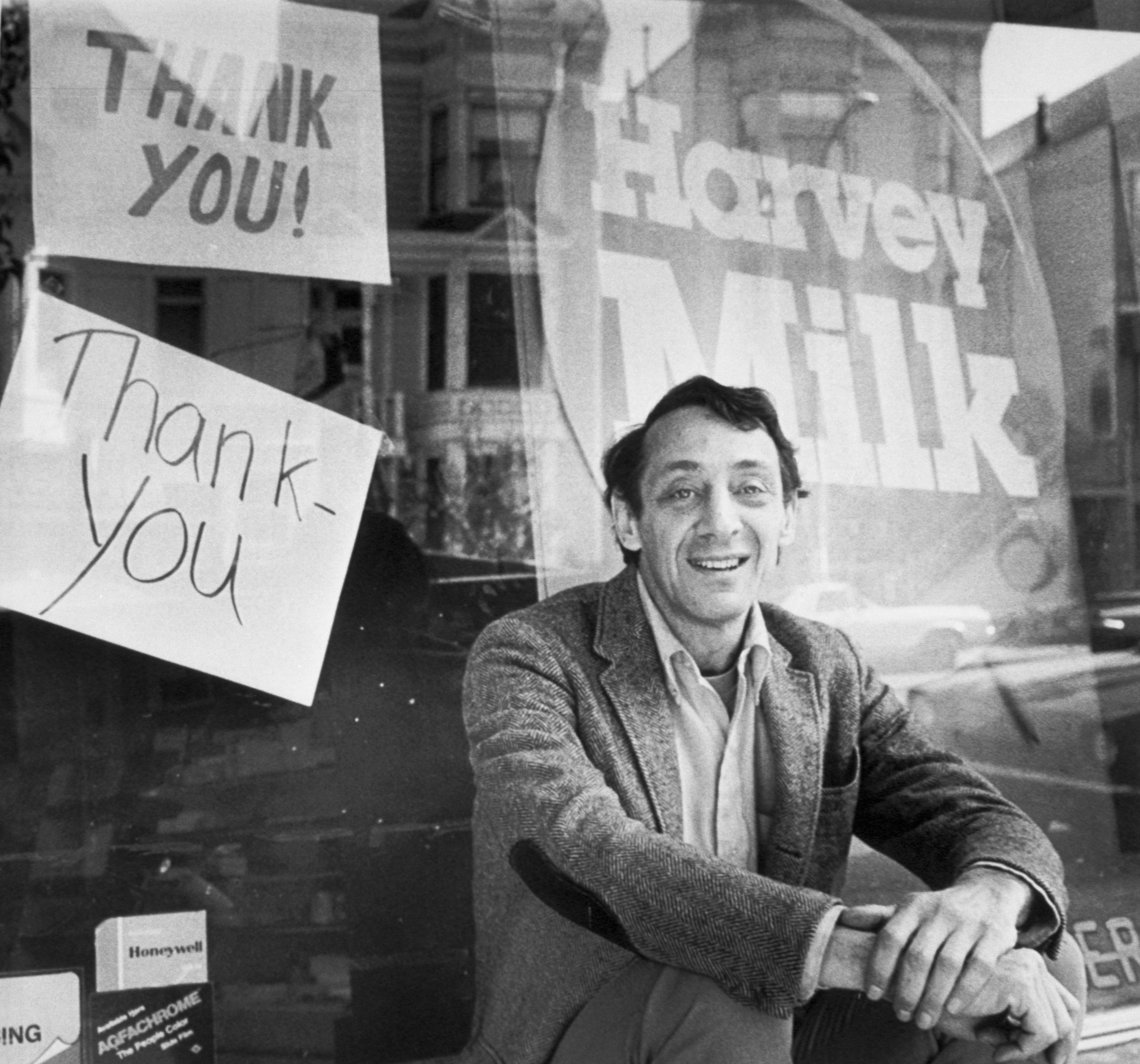 Avowed homosexual, Supervisor Harvey Milk, who was shot and killed along with San Francisco Mayor George Moscone at City Hall 11/27, sits outside his camera shop in a November 9, 1977 photo. Dan White, who recently resigned from the board and then sought reappointment, turned himself in to police shortly after the shooting. Milk was the leader of the opposition to White's reappointment.