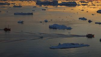 ILULISSAT, GREENLAND - JULY 23:  Ships are seen among the icebergs that broke off from the Jakobshavn Glacier as the sun reaches its lowest point of the day on July 23, 2013 in Ilulissat, Greenland.  As the sea levels around the globe rise, researchers affilitated with the National Science Foundation and other organizations are studying the phenomena of the melting glaciers and its long-term ramifications. The warmer temperatures that have had an effect on the glaciers in Greenland also have altered the ways in which the local populace farm, fish, hunt and even travel across land.  In recent years, sea level rise in places such as Miami Beach has led to increased street flooding and prompted leaders such as New York City Mayor Michael Bloomberg to propose a $19.5 billion plan to boost the citys capacity to withstand future extreme weather events by, among other things, devising mechanisms to withstand flooding.  (Photo by Joe Raedle/Getty Images)