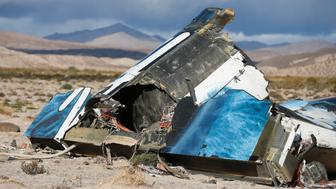 A piece of debris is seen near the crash site of Virgin Galactic's SpaceShipTwo near Cantil, California November 1, 2014. Virgin Galactic founder Richard Branson said on Saturday he was working with U.S. authorities to determine what caused a passenger spaceship being developed by his space tourism company to crash in California, killing one pilot and injuring the other. REUTERS/Lucy Nicholson   (UNITED STATES - Tags: DISASTER TRANSPORT BUSINESS)
