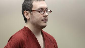 Colorado movie massacre gunman James Holmes listens at a court hearing before beginning his life sentence with no chance of parole, in Centennial, Colorado August 26, 2015. Condemning Holmes to 12 life sentences and the maximum 3,318 years in prison for his rampage in a midnight screening of a Batman film, a Colorado judge on Wednesday said evil and mental illness were not mutually exclusive. The 27-year-old was found guilty by a jury last month of murdering 12 people and wounding 70 in his rampage inside the packed screening a multiplex in the Denver suburb of Aurora.  REUTERS/RJ Sangosti/Pool