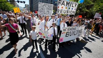 Members of the Mormon church march in a gay pride parade in Salt Lake City, Utah, June 2, 2013. Both Mormons and members of the Boy Scouts marched with members of LGBT community and their supporters as part of the Utah Pride Festival. REUTERS/Jim Urquhart (UNITED STATES - Tags: SOCIETY RELIGION)