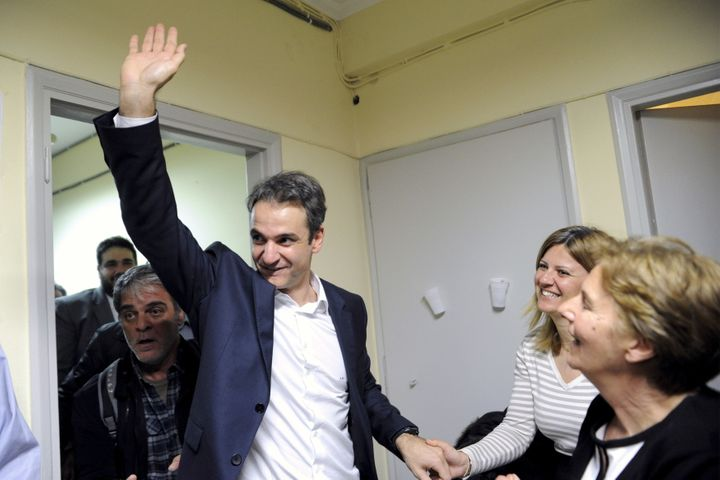 Kyriakos Mitsotakis, the newly elected leader of Greece's conservative New Democracy party, greets his supporters during his