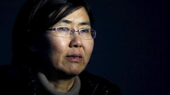 "Human rights lawyer Wang Yu talks during an interview with Reuters in Beijing in this March 1, 2014 photo. China's state media last month accused Wang, the country's most prominent female human rights lawyer, of ""blabbering about the rule of law and human rights.""  State media said on July 11, 2015 police had criminally detained Wang and some colleagues. Four lawyers taken in for questioning said police had warned them not to advocate for Wang, according to accounts by them and other activists. Picture taken on March 1, 2014.   REUTERS/Kim Kyung-Hoon"