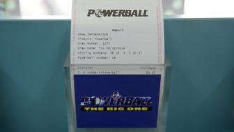 A results report for Tatts Group Ltd.'s Powerball lottery game is displayed at a newsagent's store in Melbourne, Australia, on Thursday, Dec. 15, 2016. A consortium including Morgan Stanley and KKR & Co. offered as much as A$7.3 billion ($5.5 billion) for Australian betting and lotteries business Tatts Group, setting up a potential bidding war with Tabcorp Holdings Ltd. Photographer: Carla Gottgens/Bloomberg via Getty Images