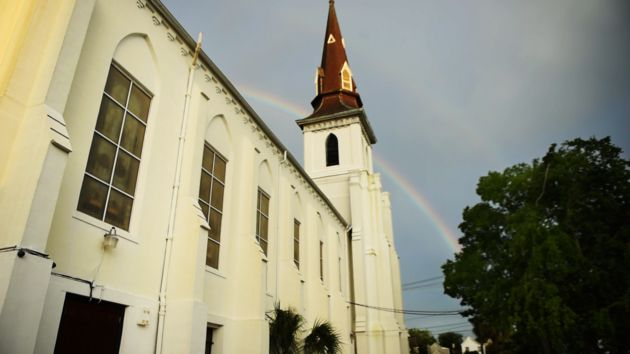 A rainbow appears outside Mother Emanuel church on June 15, 2016, following a bible