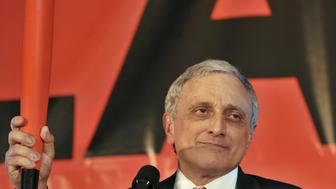 Republican gubernatorial candidate Carl Paladino holds a bat as he concedes to a crowd in Buffalo November 2, 2010. REUTERS/Gary Wiepert (UNITED STATES - Tags: ELECTIONS POLITICS)