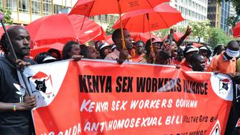 Gays and prostitutes from the Kenya Sex Workers Alliance demonstrate on December 17, 2012 in Nairobi against the persecution of  lesbians, homosexuals, bisexuals and transsexuals in the country. The Kenya Human Rights Commission and the National Gay and Lesbian Human Rights Commission on December 15 launched the first gay and lesbian awards to honor lesbians, gays, bisexuals, transsexual and intersex people for their contributions to Kenyan society to encourage inclusion, tolerance and a respect for sexual diversity. Gays in general still face persecution and discrimination from society and the authorities, including physical and verbal assault as well as arbitrary arrests.                         AFP PHOTO /STR        (Photo credit should read -/AFP/Getty Images)