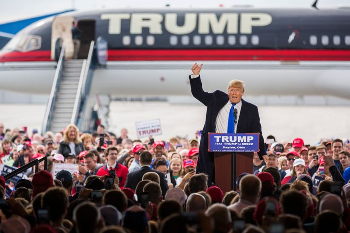 Republican Presidential candidate Donald Trump speaks at a campaign rally in front of his personal airplane, March 12, 2016 i