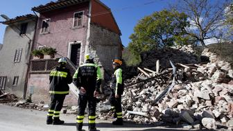 Firefighters inspect a collapsed building after an earthquake in Borgo Sant'Antonio near Visso, central Italy, October 27, 2016. REUTERS/Max Rossi