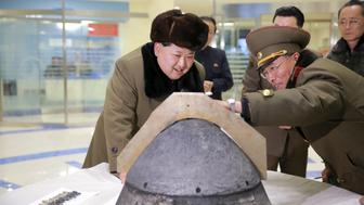 North Korean leader Kim Jong Un looks at a rocket warhead tip after a simulated test of atmospheric re-entry of a ballistic missile, at an unidentified location in this undated photo released by North Korea's Korean Central News Agency (KCNA) in Pyongyang on March 15, 2016.     REUTERS/KCNA ATTENTION EDITORS - THIS PICTURE WAS PROVIDED BY A THIRD PARTY. REUTERS IS UNABLE TO INDEPENDENTLY VERIFY THE AUTHENTICITY, CONTENT, LOCATION OR DATE OF THIS IMAGE. FOR EDITORIAL USE ONLY. NOT FOR SALE FOR MARKETING OR ADVERTISING CAMPAIGNS. THIS PICTURE IS DISTRIBUTED EXACTLY AS RECEIVED BY REUTERS, AS A SERVICE TO CLIENTS. NO THIRD PARTY SALES. SOUTH KOREA OUT. NO COMMERCIAL OR EDITORIAL SALES IN SOUTH KOREA      TPX IMAGES OF THE DAY